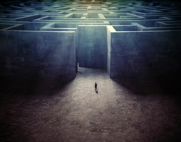 Stock illustration: Man facing a maze