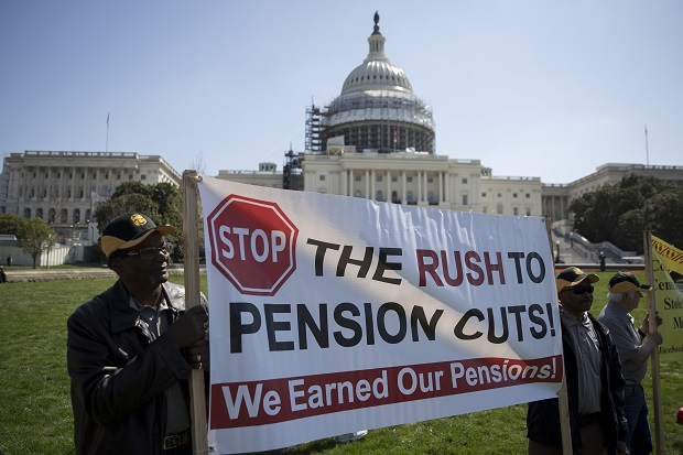 news photo of Central States Teamsters holding a sign about pension cuts in front of nation's capitol