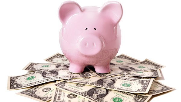 Pink piggy bank on money (Image: Shutterstock)