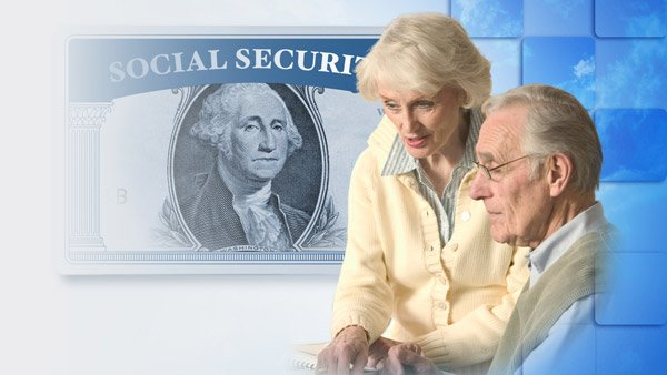 An older couple and a Social Security card (Image: Shutterstock)
