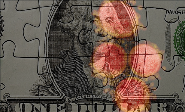 Stock image of dollar bill cut up like a puzzle with COVID-19 designs on top of it